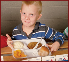 Fifth Grader with school lunch